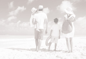 Family On Vacation Walking On The Beach